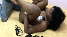 Pretty ebony Roxy uses her sexy feet to make a white nerd cum
