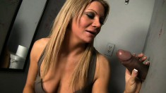 Busty blonde milf with a spicy ass Christina Skye worships a big cock at the gloryhole