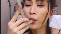 Slutty Japanese chick blows a few cocks and swallows their hot juices