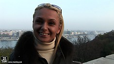 Ivana Sugar is dressed warmly and speaks nicely with a camera guy