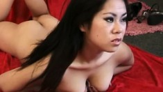 Curvy Asian nympho teases while spreading her pussy wide open