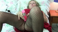 Buxom granny in sexy lingerie Isabel makes herself cum with a dildo