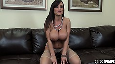 The sexy cougar seductively takes her bra off revealing her huge boobs