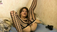 Provoking girl in fishnet pantyhose Hermione masturbates on the bed
