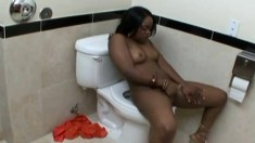 Ebony teen goes down on him in the bathroom and gets drilled