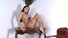 Astonishing brunette with a fabulous ass and huge tits loves to play with her twat