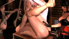 Two mistresses put a dude in a sex chair and ass fuck with a strapon