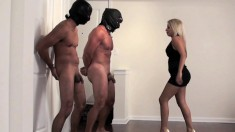 Dominant Blonde Stands Up Her Two Slaves And Knees Them In The Nut Sack