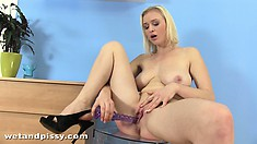 Busty blonde hottie rubs her slit and sticks in a dildo to fuck