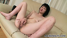 The Asian milf takes her time soaping his cock before fingering her tight peach