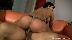Driven by desire, the big breasted milf jumps on top of him and wildly rides his dick