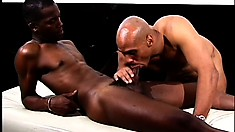 Bald gentleman spreads chocolate oil on the ass of his partner
