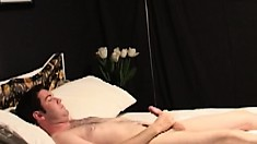 Handsome man lays back as he strokes his cock while moaning sexily