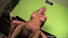 Blonde bimbo with massive fake tits gets banged on the couch