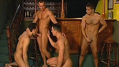Four horny hunks hook up at the bar and make good use of their gay swizzle sticks