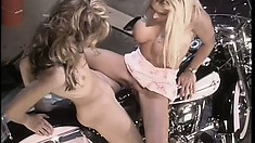 Sweet blonde lesbians drive each other's pussies to intense pleasure on a motorcycle