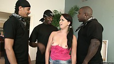 Brunette takes on three blacks in a hard hitting gangbang with hungry cocks