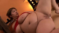 Chunky older lady shows off her talents on a couple of hard cocks