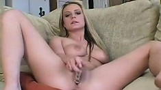 Smoking hot blonde bitch drills herself with a big glass toy