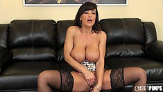 Lisa Ann spreads her legs wide open and fucks herself with a dildo