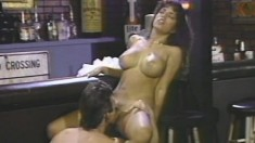 Bodacious brunette Bianca Trump gets nailed by Buck Adams in the bar