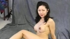 Busty Oriental milf Maya Chung loves to put her hot curves on display
