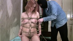 Karada gets wound up in ropes and tied to fuck by her master