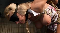 Stacked blonde goddess in white stockings feeds her desire for bondage