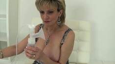Blonde bombshell bares her huge tits to test an electric nipple pump