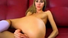 Pretty and petite blonde fingering her anal hole