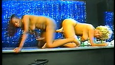 Two naughty strippers use a double-ended dildo to make each other come