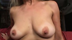 Blonde Milf shows her stuff and gets rockin' sucking and humping him