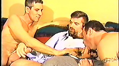 These three hot gay studs get in a triangle blowjob position