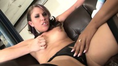 Three mesmerizing lesbians having fun with a vibrator on the couch