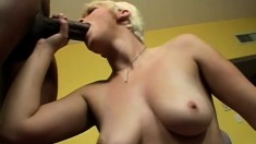 Fiery blonde college babe has a huge black stick stretching her pussy